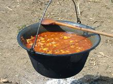 Making soup round the campfire