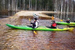 Freedom of Adventure kayaking on the flooded area in Soomaa