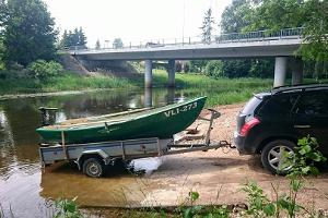 Boat with an electric engine and a trailer