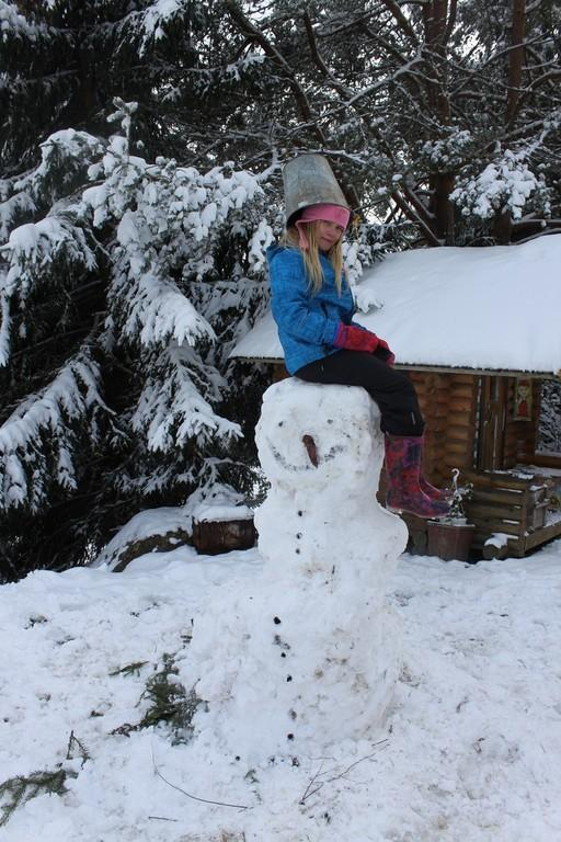 After building your own snowmen it's fun to climb up on their shoulders and enjoy the view!