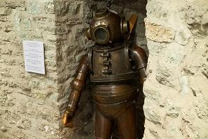 Copper diving suit on the basement level of the museum