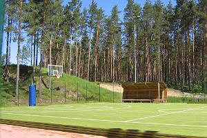 Basketball and volleyball court with a timber cover