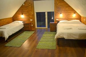 Large bedroom with a private bathroom at the Lehtla Holiday Home