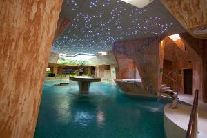 Viiking Saaga Water Centre with a starry sky and waterfalls