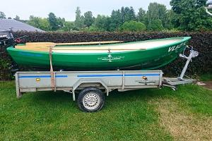 A boat, trailer and motor for rental on the River Võhandu