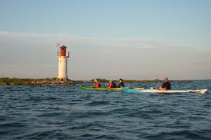 Sunset kayak tour around Manija island by Seikle Vabaks