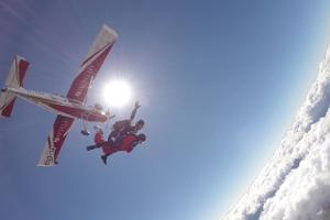 Tandem skydiving with a parachute