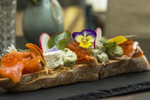Bruschetta with rainbow trout, dill mayonnaise, and trout roe