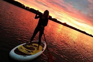SUP boarding on the River Emajõgi during sunset