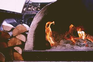 Our pizzas are made in a hot wood-burning stone oven.
