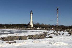 Discover the island of Kihnu in winter, lighthouse