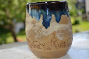 Ceramic cup with wintery villages