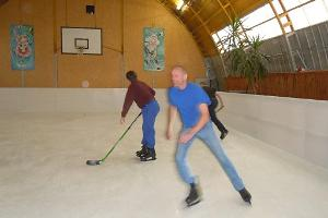 Skating and playing hockey on the skating rink with a paraffin surface