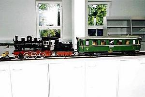 Models of an SK steam engine and passenger car.